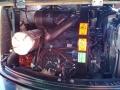 CAMS CZ 54, náhled motorového prostoru s nálepkou uvádějící osobu zodpovědnou za výstupní kontrolu